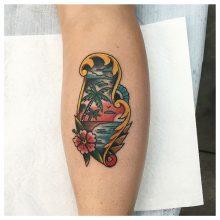 Beach tattoo by Kaleo Yangco at 1 Point Tattoo