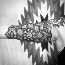 Bicep mandala tattoo by Simon Halpern at 1 Point Tattoo