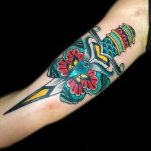 Dagger tattoo by Ash Hochman at 1 Point Tattoo