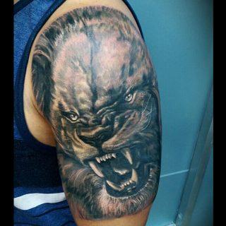 Beast bicep tattoo by Robert Bennett at 1 Point Tattoo