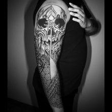 Shoulder skull tattoo by Simon Halpern at 1 Point Tattoo