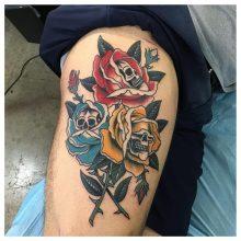Skulls in roses tattoo by Kaleo Yangco at 1 Point Tattoo