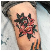 Woman in rose tattoo by Kaleo Yangco at 1 Point Tattoo