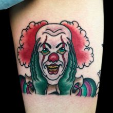 Clown tattoo by Ash Hochman at 1 Point Tattoo