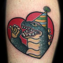 Godzilla Birthday tattoo by Ash Hochman at 1 Point Tattoo