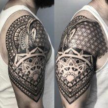 Shoulder and bicep mandala tattoo by Simon Halpern at 1 Point Tattoo