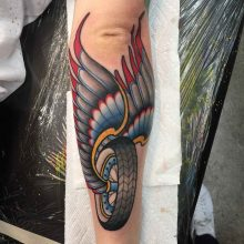 Winged wheel tattoo by Ash Hochman at 1 Point Tattoo
