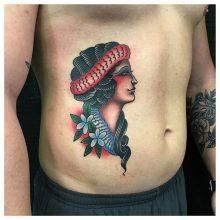 Woman tattoo by Kaleo Yangco at 1 Point Tattoo