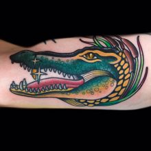 Alligator and cattails tattoo by Ash Hochman at 1 Point Tattoo