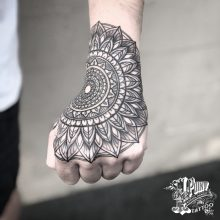 mandala hand tattoo by Simon Halpern at 1 Point Tattoo
