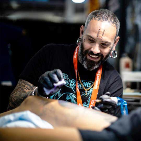 Robert Bennett tattoo artist at 1 Point Tattoo
