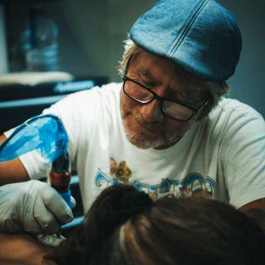 Josh Flinn tattoo artist at 1 Point Tattoo