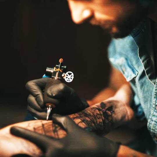 Judd Bowman tattoo artist at 1 Point Tattoo
