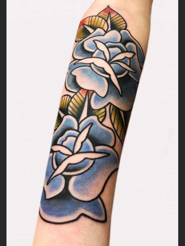 Ash Hochman flower tattoo