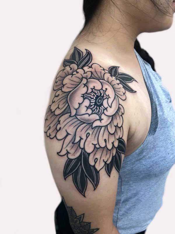 Ash Hochman full shoulder flower tattoo