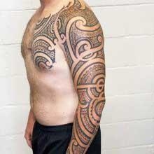Josh Flinn full sleeve tattoo of polynesian design
