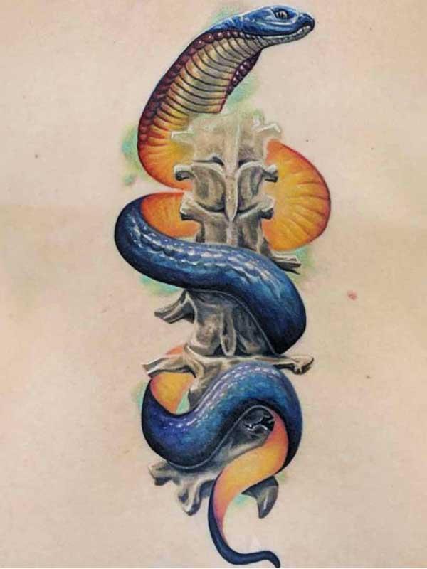 Robert Bennett cobra tattoo on back