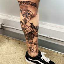 Tattoo of skull mariachi player be Vincent Samaniego