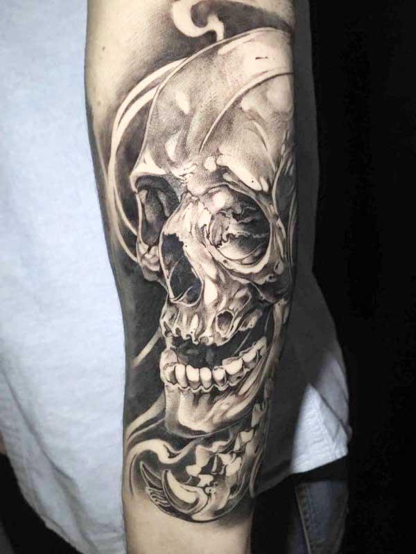 Vincent Samaniego skull tattoo